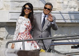 U.S. Actor George Clooney and his wife Amal Alamuddin leave the seven-star hotel