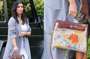 Foto: Kim Kardashian y su bolso pintado por North, sumándose a la moda de Angelina y Brad Pitt (CORDON PRESS)