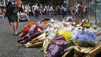Una  ostatge de la cafeteria de Sydney va morir per trets de la Policia