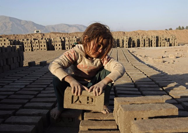 Afghan girl works at a brick-making factory in Nangarhar