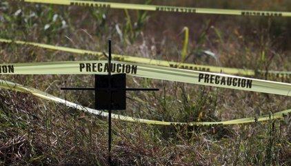 Comienza la exhumación de los 116 cadáveres hallados en una fosa en Morelos