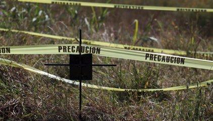 Exhumados 13 cuerpos de dos fosas comunes con 116 cadáveres en México