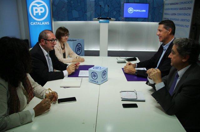 Xavier García Albiol (PP), Enric Millo (PP) y Rafael Arenas (SCC)