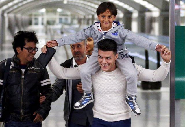 El refugiado sirio y dos de sus hijos