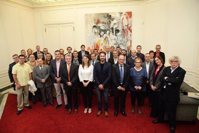 La consellera M.Serret con los maestros artesanos alimentarios premiados