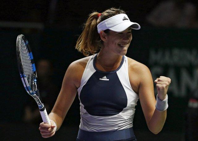 Muguruza celebra su victoria ante Safarova en Singapur