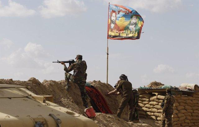 Milicianos chiíes progubernamentales en Irak