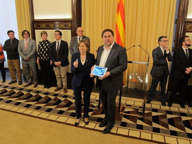La presidenta del Parlament, C.Forcadell, y el conseller de Economía,O.Junqueras