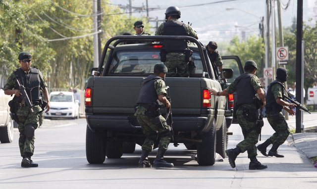 Soldiers take part in a military operation to capture drug kingpin Hector Huerta