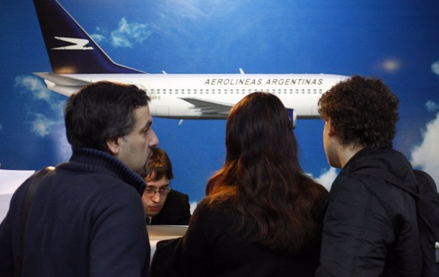 Passengers check in at a Aerolineas Argentinas desk at Buenos Aires' domestic ai