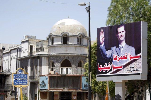 Cartel de Bashar al Assad en Homs, Siria