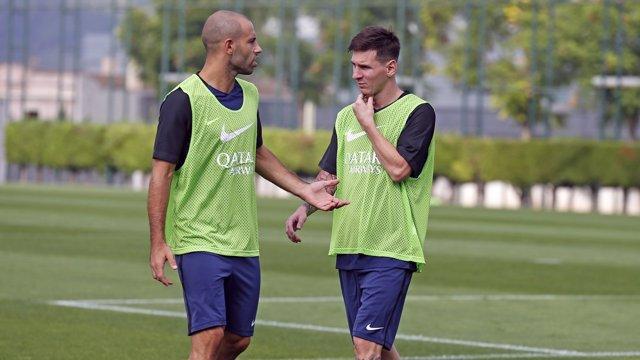 Mascherano i Messi en l'entrenament del Barcelona