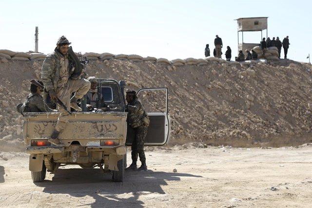 Syrian Democratic Forces (SDF) gather in northern Deir al-Zor province ahead of