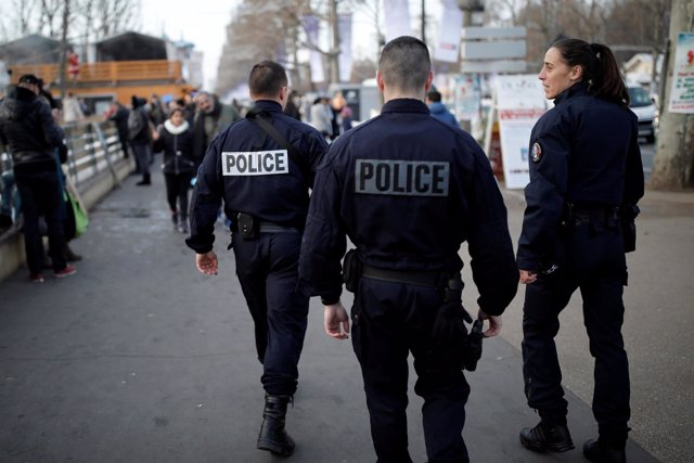 French police officers patrol a Christmas market on the Champs Elysees Avenue as