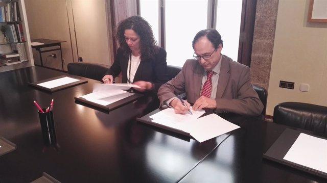 Firma de un documento sobre financiación autonómica entre Valencia y Baleares