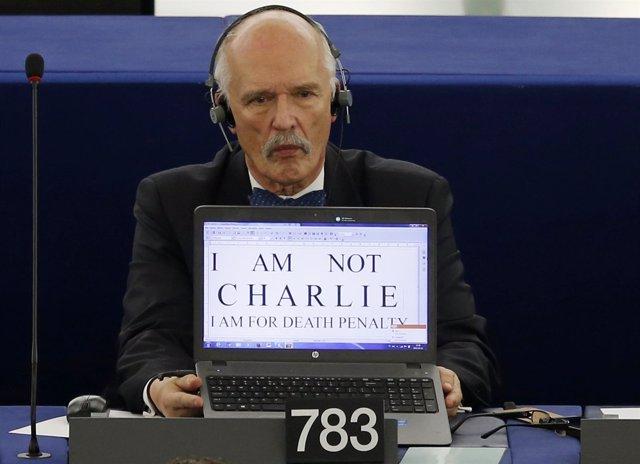 Polish Member of the European Parliament Janusz Korwin-Mikke displays the slogan