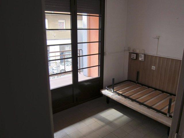 Habitación vacía en la Casa Bloc. Refugiados, vivienda, pisos vacíos