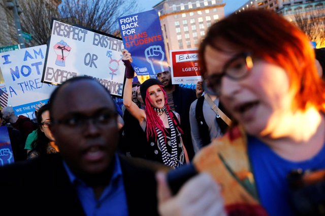 Transgender activists and supporters protest potential changes by the Trump admi