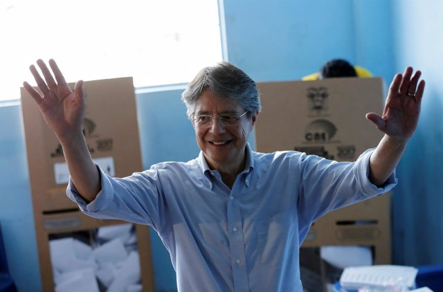 Guillermo Lasso, presidential candidate from the CREO party, waves before castin